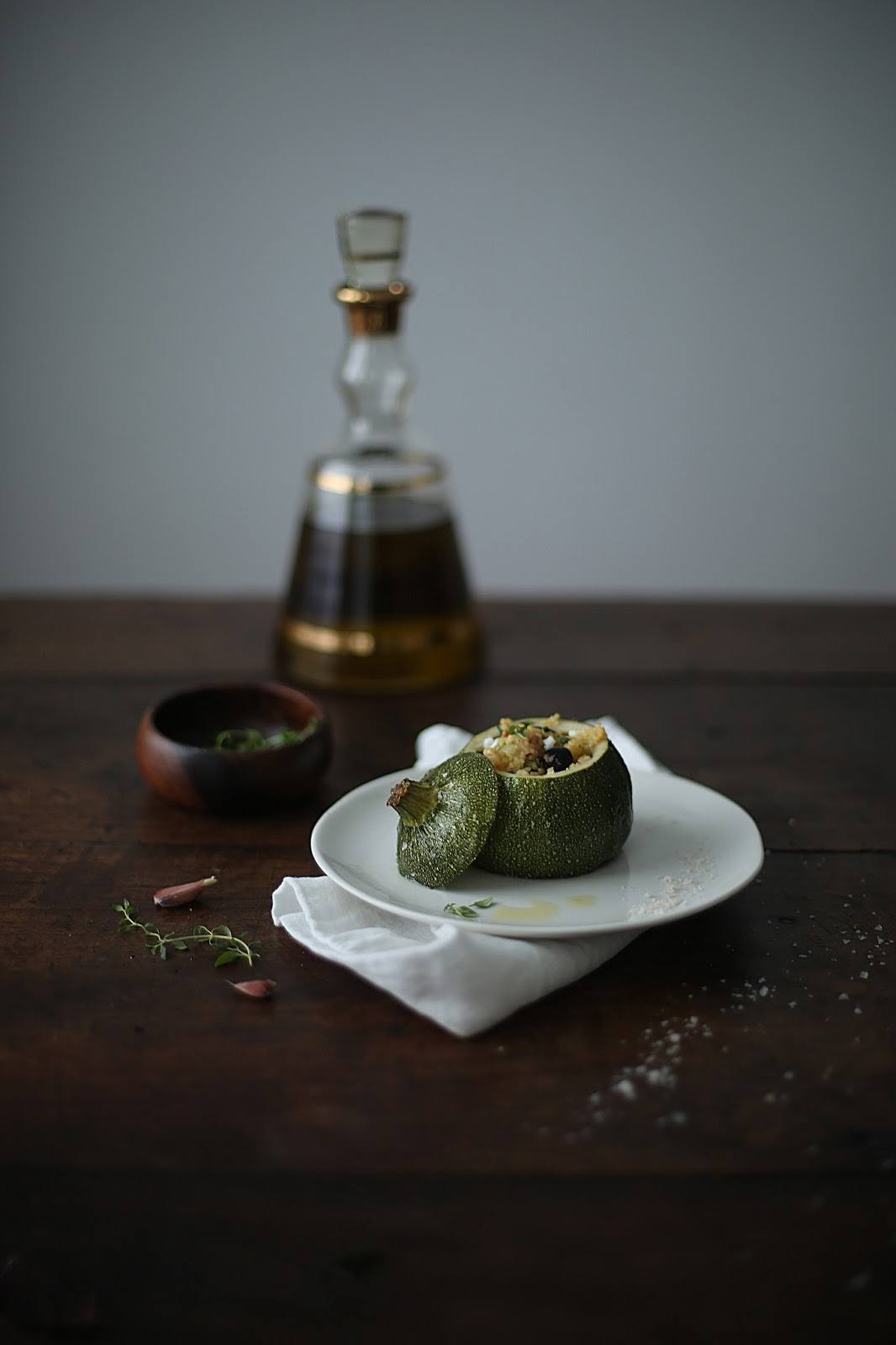 Stuffed Eight Ball Zucchini with Millet, Olives and creamy Goat Cheese
